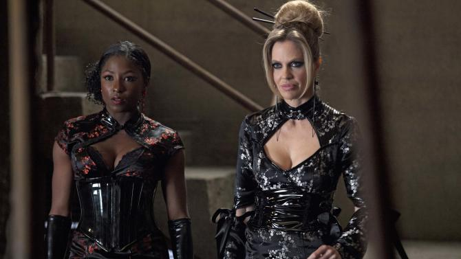 "This image released by HBO shows Rutina Wesley, left, and Kristin Bauer van Straten in a scene from ""True Blood."" The 17th annual ""Where We Are on TV"" report released Friday by the Gay & Lesbian Alliance Against Defamation (GLAAD) found that 4.4 percent of actors appearing regularly on prime-time network drama and comedy series during the 2012-13 season will portray lesbian, gay, bisexual or transgender (LGBT) characters. This is up from 2.9 percent in 2011, which saw a dip in what had been a growing trend. The HBO drama ""True Blood"" remains the most inclusive series on cable television, featuring six LGBT characters. (AP Photo/HBO, John P. Johnson)"