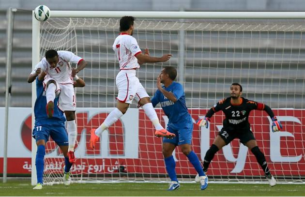 Ahmad Khalil (L front) of United Arab Emirates vies for the ball against Fahed al-Ibrahim (back) during the two teams' semi final match in the 21st Gulf Cup in Manama, on January 15, 2013. AFP PHOTO/M
