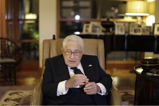 In this Saturday, March 28, 2015 photo, Former U.S. Secretary of State Henry Kissinger speaks to reporters after paying his respects to the late Lee Kuan Yew, in Singapore. Lee, 91, died March 23, 201