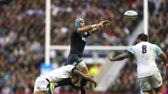 England's Lawes tackles Argentina's Amorosino during their international rugby union match at Twickenham in London