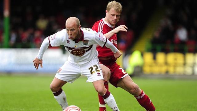 Football - Duo leave Cobblers
