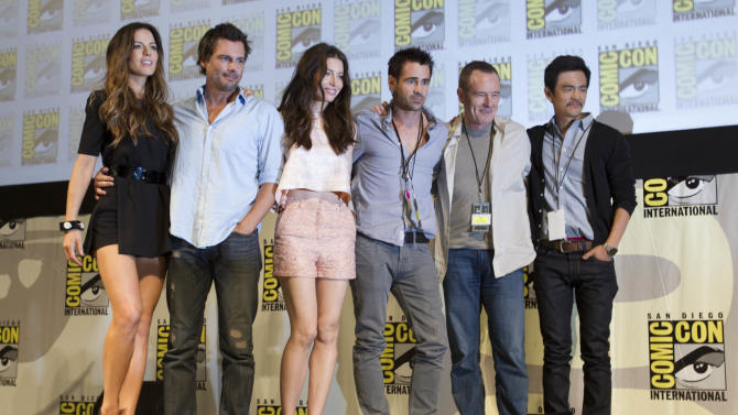 """Cast and crew members of the movie, """"Total Recall"""" pose during the Sony panel at Comic Con  Friday, July 22, 2011, in San Diego. They are, from left, Kate Beckinsale, Len Wiseman, Jessica Biel, Colin Farrell, Bryan Cranston, and John Cho. (AP Photo/Gregory Bull)"""