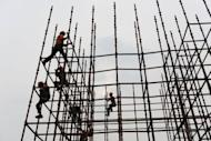 Chinese labourers work at a construction site in Hefei, in eastern China's Anhui province. China's annual growth slowed to 9.2 percent last year from 10.4 percent in 2010, prompting the government to cut its economic growth target to 7.5 percent this year, in an official acknowledgement that the export-driven economy is slowing