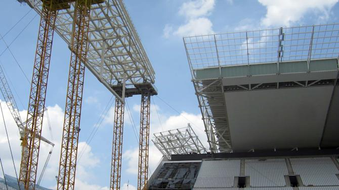 Damage to the roof from last month's crane collapse can be seen in the Arena Sao Paulo stadium in Sao Paulo