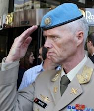 "The UN's Syria mission leader Major General Robert Mood, pictured in Damascus on June 5, told the UN Security Council of the intensifying violence in the country but said the nearly 300 unarmed monitors were ""morally obliged"" to stay"