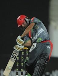 Afghanistan's cricketer Asghar Stanikzai plays a shot during a day-night international against Australia at the Sharjah cricket stadium. Former world champions Australia defeated a battling Afghanistan team by 66 runs in the first-ever limited overs international between the two sides