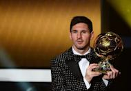 FIFA Ballon d'Or award winner Barcelona's Argentinian forward Lionel Messi poses with his trophy after the FIFA Ballon d'Or awards ceremony at the Kongresshaus in Zurich on January 7, 2013