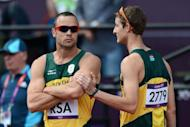 South Africa's Oscar Pistorius (L) reacts next to South Africa's Willem de Beer at the athletics event during the London 2012 Olympic Games in London. Double amputee Pistorius's landmark Olympic campaign gained a reprieve on Thursday as South Africa were given a place in Friday's 4x400m relay final on appeal