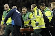 "Bolton's midfielder Fabrice Muamba is stretched from the pitch while being treated by medical staff after collapsing during the English FA Cup quarter-final football match at White Hart Lane in north London. Muamba was ""critically ill"" in a London hospital on Saturday after his collapse against Tottenham, a joint hospital and club statement said"