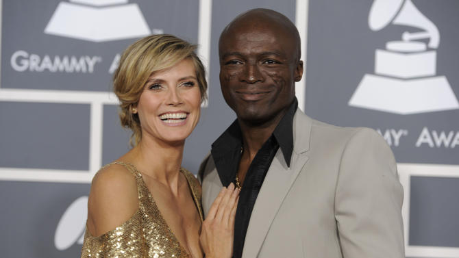 "FILE - In this Feb. 13, 2011 file photo, Heidi Klum, left, and Seal arrive at the 53rd annual Grammy Awards in Los Angeles. In a statement Sunday, Jan. 22, 2012, the power-couple announced their separation. They say after ""much soul searching"" they've decided to separate, and blame the breakup on ""growing apart."" They married in 2005. (AP Photo/Chris Pizzello, File)"