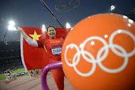 China's Zhang Wenxiu celebrates believing that she won the bronze medal in the women's hammer throw final at the London 2012 Olympic Games. She was later denied the medal and lost an appeal