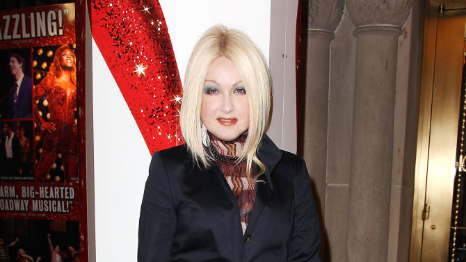 "This Feb. 28, 2013 photo released by Starpix shows, Cyndi Lauper at the open house for the Upcoming Musical ""Kinky Boots,"" featuring Music by Cyndi Lauper, at the Al Hirshfeld Theatre in New York. The Cyndi Lauper-scored ""Kinky Boots"" has earned a leading 13 Tony Award nominations, Tuesday, April 30, 2013. ""Kinky Boots"" is based on the 2005 British movie about a real-life shoe factory that struggles until it finds new life in fetish footwear. Lauper's songs and a story by Harvey Fierstein have made it a crowd-pleaser. (AP Photo/Starpix, Kristina Bumphrey)"