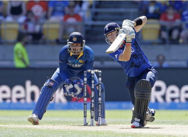 Sri Lanka's wicket keeper Sangakkara watches as England's Root plays a shot during their Cricket World Cup match in Wellington