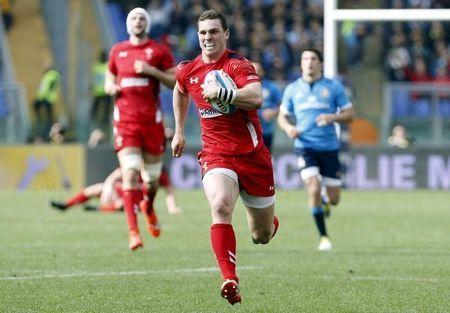 Wales' North runs with the ball to score a try against Italy during their Six Nations Rugby Union match in Rome