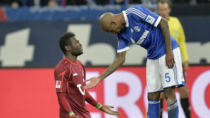 Hannover's Mame Diouf of Senegal, left, refuses to shake hands with Schalke's Felipe Santana of Brazil, right, during the German Bundesliga soccer match between FC Schalke 04 and SV Hannover 96 in Gelsenkirchen,  Germany, Sunday, Feb. 9, 2014