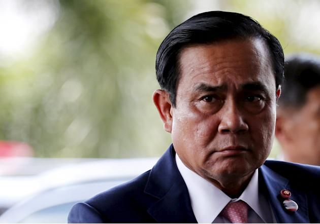 Thailand's Prime Minister Prayuth Chan-ocha arrives at a meeting with his economic cabinet at the Army club in Bangkok