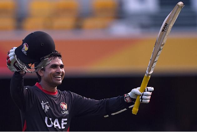 UAE batsman Shaiman Anwar celebrates after scoring his century during the Cricket World Cup match against Ireland in Brisbane on February 25, 2015
