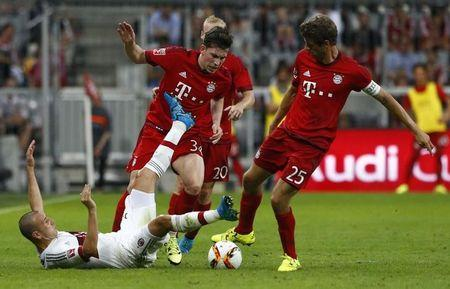 AC Milan's Alex fights for the ball with Bayern Munich's Hojbjerg and Mueller during their pre-season Audi Cup tournament soccer match in Munich