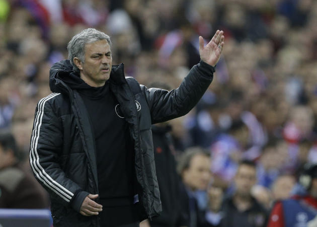 Chelsea's manager Jose Mourinho gestures as he watches his team from the technical area during the Champions League semifinal first leg soccer match between Atletico Madrid and Chelsea at the Vice