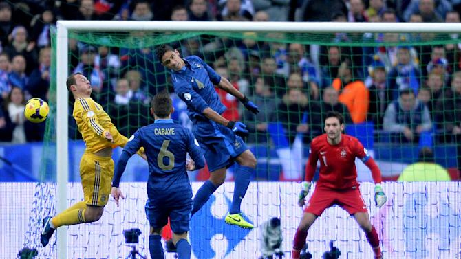 PARIS, Nov. 20, 2013 (Xinhua/IANS) -- Raphael Varane (2nd R) of France heads the ball during the 2014 World Cup qualifying second leg playoff soccer match between France and Ukraine in Paris, France, on Nov. 19, 2013. France won 3-2 in total to be qualified for the final stage of the 2014 World Cup. (Xinhua/Chen Xiaowei)