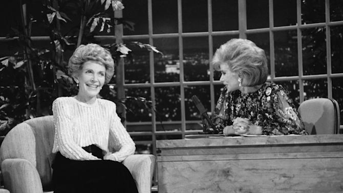 "FILE - In this Oct. 30, 1986 file photo, talk show host Joan Rivers, right, talks with guest, first lady Nancy Reagan, during her appearance on ""The Late Show Starring Joan Rivers,"" on Fox TV. The role of female talk-show hosts in late-night TV network history, all 50-plus years of it, can be summed up in two words: Joan Rivers. It takes just another two _ Arsenio Hall _ to do the same for minorities. There's no indication that's going to change in the latest round of musical chairs involving ""Tonight"" and ""Late Night."" (AP Photo, Reed Saxon, File)"