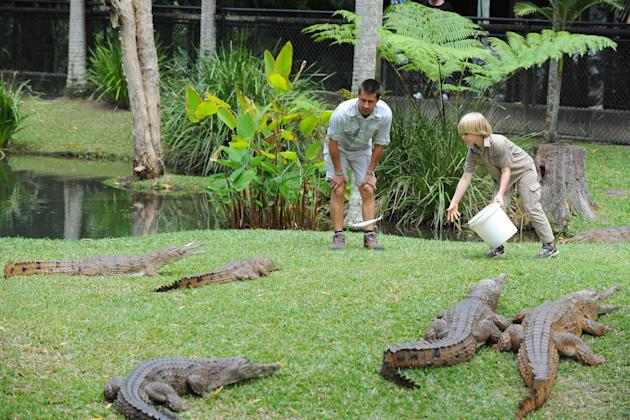 SUNSHINE COAST, AUSTRALIA - OCTOBER 2: In this handout photo provided by Australia Zoo, Robert Irwin (R) feeds freshwater crocodiles with Australia Zoo's Head of Reptiles, Josh Ruffell at Australia Zoo on October 2, 2012 on the Sunshine Coast, Australia. Robert Irwin, 8, feed freshwater crocodiles for the first time publicly today. (Photo by Ben Beaden/Australia Zoo via Getty Images)