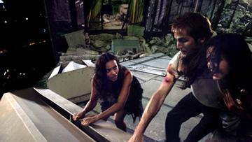 Jessica Lucas , Michael Stahl-David and Odette Yustman in Paramount Pictures' Cloverfield