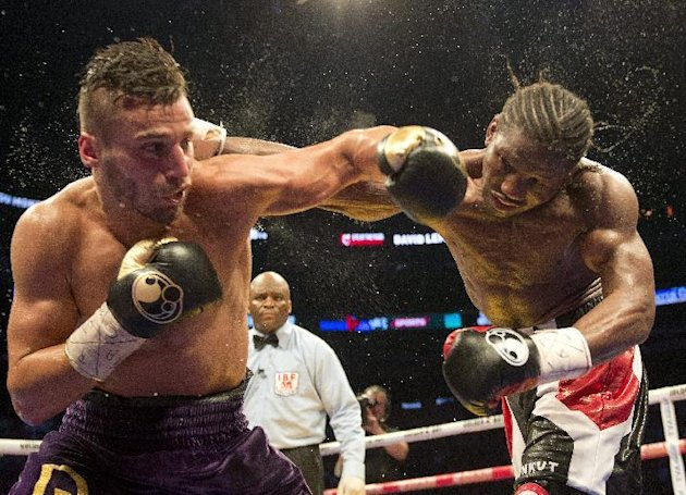 FILE - In this June 20, 2015, file photo, David Lemieux, left, from Montreal, trades punches with Hassan N'Dam, from France, during the 12th round of their boxing match for the vacant IBF middleweight title in Montreal. Lemieux won the bout with a unanimous decision. Lemieux will meet Gennady Golovkin in a three-belt middleweight title unification bout next Oct. 17, 2015, in New York. Lemieux (34-2, 31 KOs) is the IBF middleweight champion, while Golovkin (33-0, 30 KOs) holds the WBA belt and the WBC interim belt. (Ryan Remiorz/The Canadian Press via AP, File)