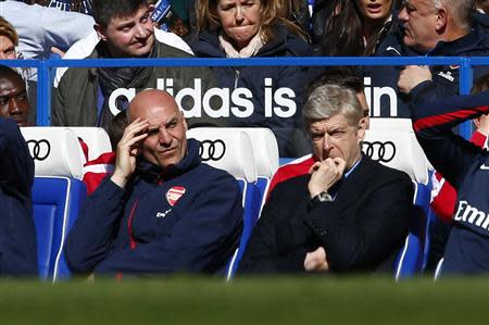 Arsenal manager Wenger and team coach Bould react during their English Premier League soccer match against Chelsea at Stamford Bridge in London