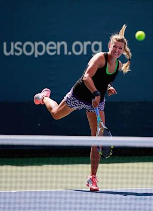 Victoria Azarenka of Belarus returns a shot during practice prior to the start of the 2013 US Open at the USTA Billie Jean King National Tennis Center on August 23, 2013 in New York City -- Getty Images