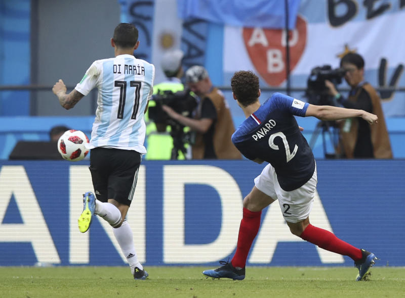 FILE - In this Saturday, June 30, 2018 filer, France's Benjamin Pavard scores his side' second goal during the round of 16 match between France and Argentina, at the 2018 soccer World Cup at the Kazan Arena in Kazan, Russia. Benjamin Pavard has beaten Juan Quintero into second place in a fans' online vote to pick the best goal of the World Cup. France defender Pavard's spinning right-foot shot against Argentina in the round of 16 came top out of 18 candidates for the award. FIFA says more than three million votes were logged on its website. (AP Photo/Thanassis Stavrakis, File)