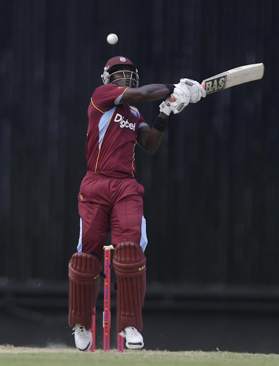 West Indies' Darren Sammy hits a six off England's Chris Jordan during their first one-day international cricket match at the Sir Vivian Richards Cricket Ground in St. John's, Antigua, Fri