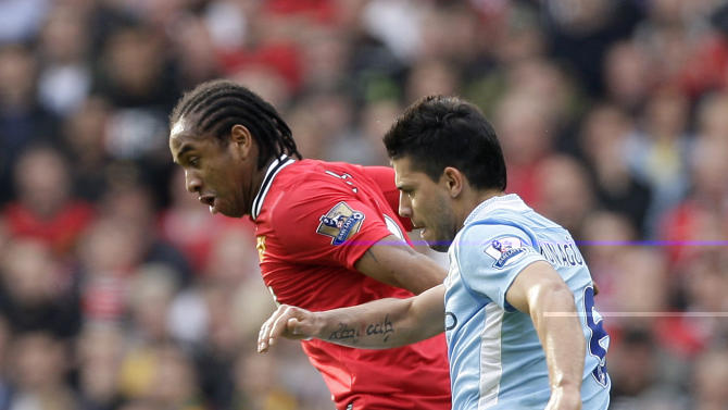 Manchester United's Anderson, left, fights for the ball with Manchester City's Sergio Aguero during their English Premier League soccer match at Old Trafford Stadium, Manchester, England, Sunday Oct. 23, 2011. (AP Photo/Jon Super)