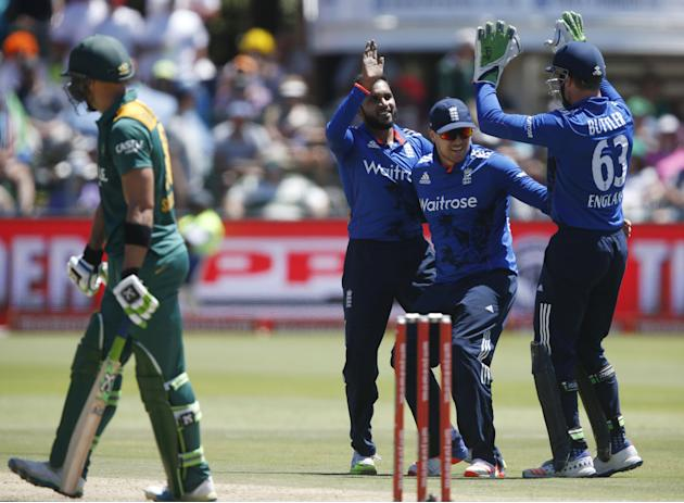 England's Adil Rashid celebrates with team-mates Jason Roy and Jos Buttler after dismissing South Africa's Faf du Plessis during their second One-Day International cricket match in Port Elizab