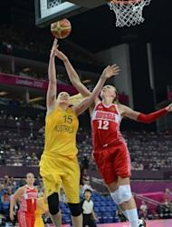 Russian centre Irina Osipova (R) jumps for the ball with Australian centre Lauren Jackson during the London 2012 Olympic Games women's bronze medal basketball game at the North Greenwich Arena in London. Australia won 83-74