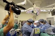 """This undated image released by ABC shows the filming of an operating room at a New York hospital for the documentary series, """"NY Med."""" The eight-episode """"NY Med,"""" produced by Terence Wrong, takes narrative devices and character building techniques from fiction but all situations are completely true, filmed by a team that immersed itself for four months in the life at the Columbia and Weill Cornell Medical Centers of New York-Presbyterian Hospital in Manhattan. The series premieres Tuesday, July 10 at 10:00 p.m. EST on the ABC Television Network. (AP Photo/ABC, Donna Svennevik)"""