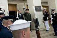 US Secretary of Defense Leon Panetta (L) and Chinese Defense Minister Gen. Liang Guanglie listen to the Chinese national anthem during an honor cordon prior to talks at the Pentagon