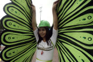 A gay participant spreads his butterfly wings during the annual Pride March in Manila, Philippines, Saturday, Dec. 3, 2011. Lesbians, gays, bisexual and transgenders called for the urgent need to pass the anti-discrimination bill and for government protection from hate crimes committed against them. (AP Photo/Pat Roque)