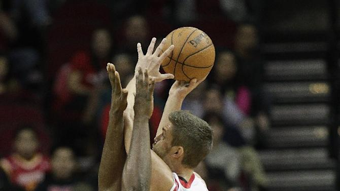 Houston Rockets small forward Chandler Parsons (25) is fouled by Orlando Magic power forward Jason Maxiell (54) as he drives to the basket during the second quarter of an NBA basketball game on Sunday, Dec. 8, 2013, in Houston