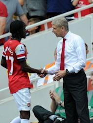 Arsenal's manager Arsene Wenger shakes hands with striker Gervinho (L) after he is substiuted during their English Premier League football match against Southampton at The Emirates Stadium in north London