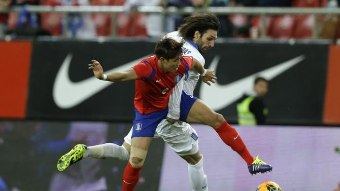 Greece's Giorgos Samaras, right, and South Korea's Hong Jeongho in action during a friendly match at Georgios Karaiskakis stadium in Piraeus port, near Athens, Wednesday, March 5, 2014