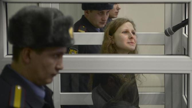 Jailed feminist punk band Pussy Riot member Maria Alekhina is seen in a cell at a court room in the town of Berezniki, some 1500 km (940 miles) north-east of Moscow, Russia, on Wednesday, Jan. 16, 2013. A Russian court on Wednesday turned down her attempt to defer serving her sentence until her preschool son becomes a teenager. Alekhina  was convicted last year along with two other band members of hooliganism motivated by religious hatred for an anti-President Vladimir Putin stunt in Russia's main cathedral. (AP Photo/Alexander Agafonov)