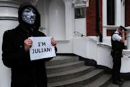 A protester wearing a Guy Fawkes mask demonstrates outside the Ecuadorian embassy in London, on June 23, 2012, where Wikileaks founder Julian Assange is seeking political asylum. Assange Monday called for diplomatic guarantees he will not be pursued by the United States for publishing secret documents if he goes to Sweden to face criminal allegations