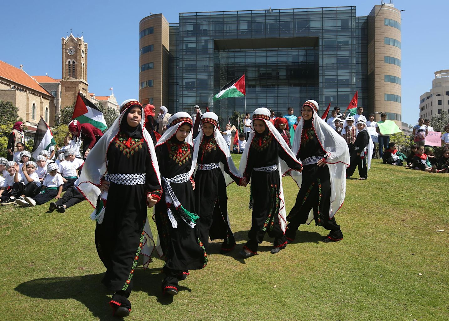 Palestinians girls perform the traditional palestinian foot stomping