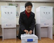 South Korean presidential candidate Park Geun-Hye casts her ballot at a polling station in Seoul, on December 19, 2012. South Korea has elected its first female president, handing a slim but historic victory to Park, daughter of the country's former military ruler