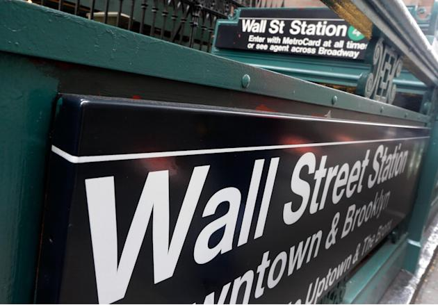FILE-This Oct. 29, 2014 file photo shows the Wall Street subway stop on Broadway, in New York's Financial District.  U.S. stocks are falling broadly in early trading on Friday, April 17, 2015,  fo