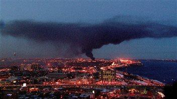 A massive fire broke out late Friday afternoon in a warehouse storing oil reservoirs in eastern Montreal.