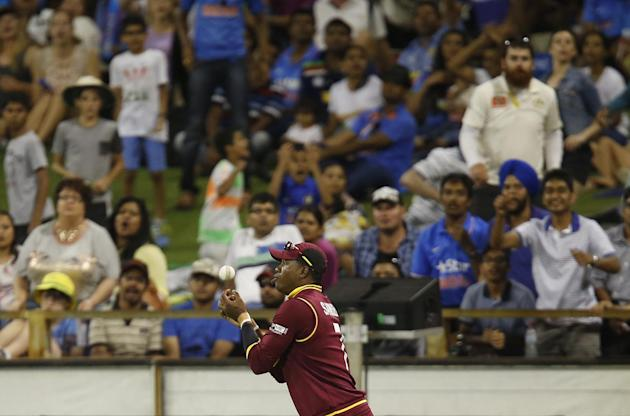 West Indies fieldsman Marlon Samuels takes a catch to dismiss India's Ravindra Jadeja during their Cricket World Cup Pool B match in Perth, Australia, Friday, March 6, 2015. (AP Photo/Theron Kirkm
