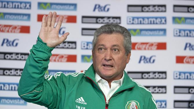 "Victor Manuel Vucetich waves during his presentation as the new coach for Mexico's national soccer team in Mexico City, Thursday, Sept. 12, 2013.  Vucetich is one of the most successful coaches in the local league, where hes known as ""King Midas"" after winning 14 of 15 the finals he has managed in his career.  He replaces Jose Manuel De la Torre who was fired on Saturday after a loss to Honduras"