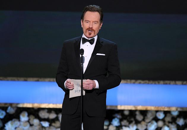 FILE - In this Jan. 25, 2015 file photo, Bryan Cranston presents the award for outstanding female actor in a comedy series on stage at the 21st annual Screen Actors Guild Awards at the Shrine Auditori
